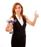 Business woman with trophy make thumps up. Business woman winning a trophy isolated on white background royalty free stock photo