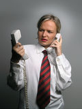 Business woman in trouble with phones Stock Images