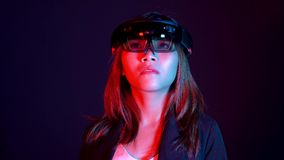 Business woman try vr glasses hololens in the dark room | Portrait of young asian girl experience ar communication | Future. Technology concept stock video