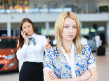 Business woman trying to calm down dissatisfied customer woman Stock Photos
