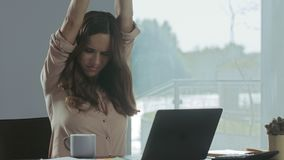 Business woman trying to relax. Tired woman relaxing at remote workplace. Business woman trying to relax in luxury house. Tired woman relaxing at remote stock footage