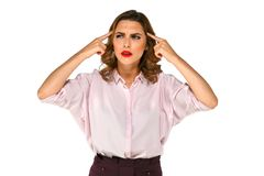 Business woman trying to remember something. Charming business woman with serious face trying to remember something, holding her head with fingers, isolated on royalty free stock photography