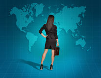 Free Business Woman Turned Back Looks At The World Map Royalty Free Stock Image - 51407846