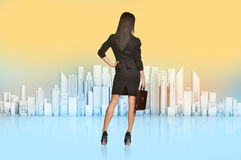 Business woman turned back looks at the city Royalty Free Stock Photos