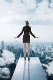 Business woman turned back on trampoline Stock Images