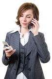 Business woman with two mobile phones stock photos