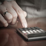 Business woman typing on calculator Stock Photography