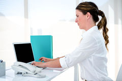 Business woman typing on her laptop Royalty Free Stock Photo