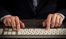 Woman typing on keyboard. Business woman typing on keyboardn royalty free stock image