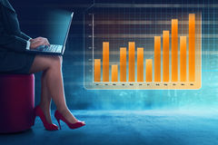 Business woman typing with laptop. With chart background Royalty Free Stock Photos