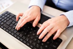 Business woman typing on laptop. Close up on hands and keyboard Stock Images