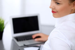 Business woman is typing on laptop computer. Bookkeeper or female financial inspector  making report, calculating or checking balance Stock Photography