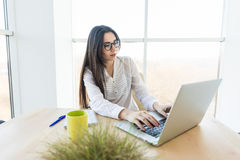 Business woman typing on laptop. In her office Royalty Free Stock Image
