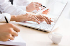 Business woman typing on laptop keyboard. Closeup of business woman typing on laptop keyboard Royalty Free Stock Photos