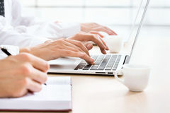 Business woman typing on laptop keyboard. Closeup of business woman typing on laptop keyboard Stock Photography