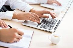Business woman typing on laptop keyboard. Closeup of business woman typing on laptop keyboard Royalty Free Stock Image