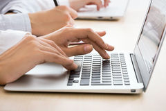 Business woman typing on laptop keyboard. Closeup of business woman typing on laptop keyboard Royalty Free Stock Photography