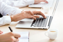 Business woman typing on laptop keyboard. Closeup of business woman typing on laptop keyboard Royalty Free Stock Images