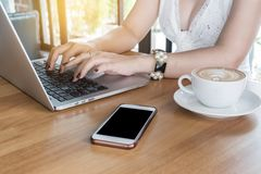 Business woman typing laptop keyboard. For online shopping at coffee shop Royalty Free Stock Photography