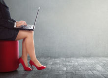 Business woman typing with laptop. Over wall background Stock Image