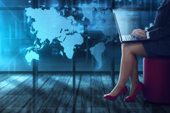Business woman typing with laptop. Over world background Royalty Free Stock Image