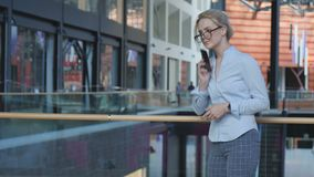 Business woman typing text message on phone. Portrait of young business woman typing text message on phone stock video