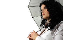 Business woman with umbrella. Isolated portrait of a beautiful business woman holding a white umbrella. Concept of protection and insurance from mobbing at work Stock Photography