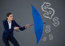 Business woman with umbrella against grey background and white money graphics Stock Images