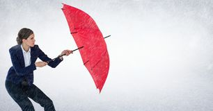 Business woman with umbrella blocking rain against white background Stock Images