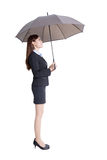 Business woman with umbrella Stock Images