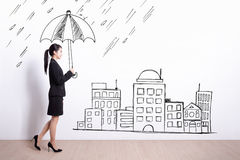 Business woman with umbrella Stock Image