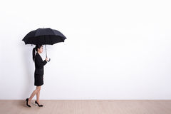 Business woman with umbrella Royalty Free Stock Image