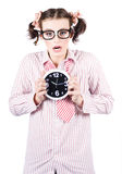 Business Woman Under Stress Holding Alarm Clock Royalty Free Stock Photography