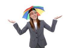 Business Woman Under Umbrella. A pretty business woman under a rainbow hat umbrella Royalty Free Stock Photo