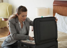 Business woman unpack luggage in hotel room Royalty Free Stock Photography