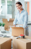 Business woman unpacking in her new office Royalty Free Stock Photography