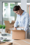 Business woman unpacking in her new office Royalty Free Stock Image