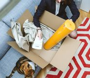 Business woman unpacking unboxing cardboard box box containing y stock photo