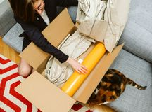 Business woman unpacking unboxing cardboard box box containing y royalty free stock photo