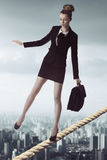 Business woman in unstable balance Stock Image