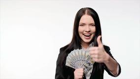 Business woman with us dollar money. Closeup of young business woman with us dollar money in hand enjoying success gesturing thumb up, ok signs stock footage