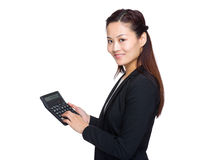 Business woman use calculator Royalty Free Stock Image