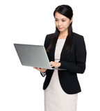 Business woman use laptop computer Stock Images