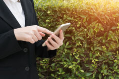 Business woman use of mobile phone. Stock Image