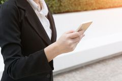 Business woman use of mobile phone. Stock Photos