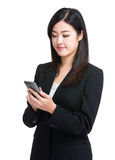 Business woman use mobile phone Stock Photo