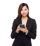 Business woman use mobile phone Stock Photography