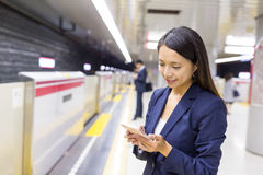Business woman use of mobile phone in the platform Royalty Free Stock Image