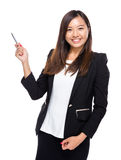 Business woman use pen to point out Stock Photos