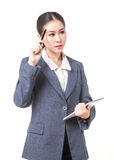 Business woman use pen touch her head when thinking Royalty Free Stock Images
